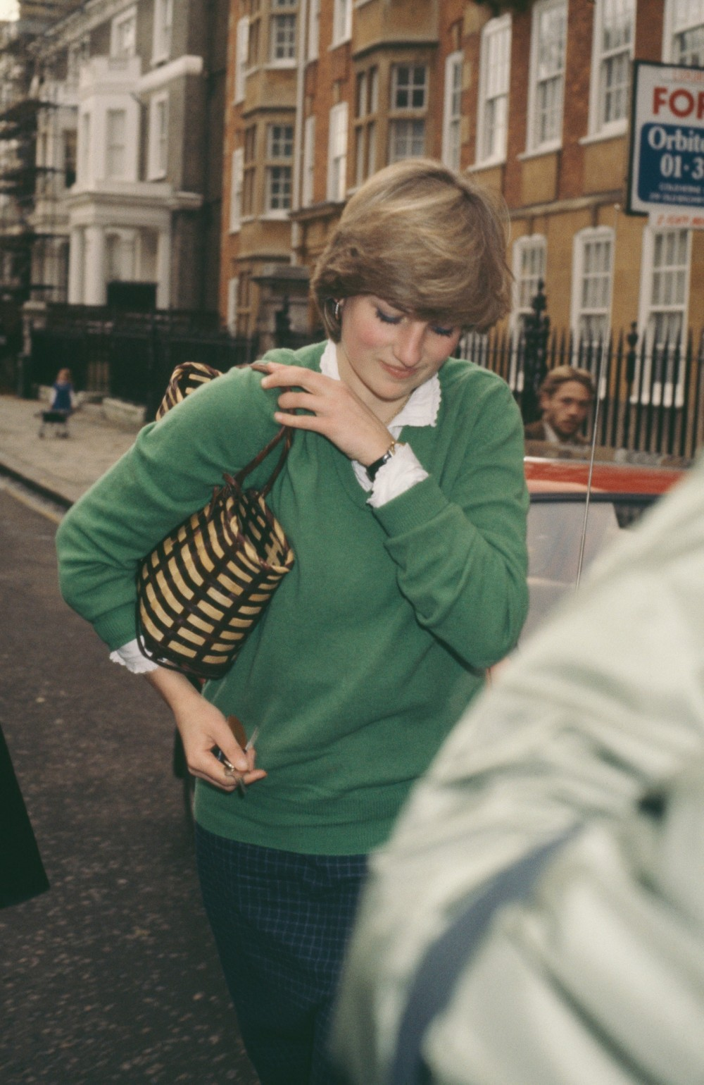 A paparazzi photo of sweaterclad Diana from 1980.