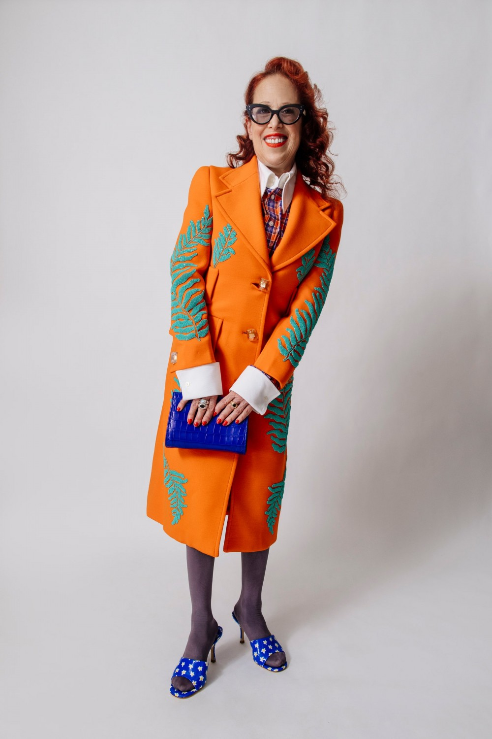 pCathy Paul Marinas former Barneys New York colleague models the Colette mules and a Prada coat that she says is one of...