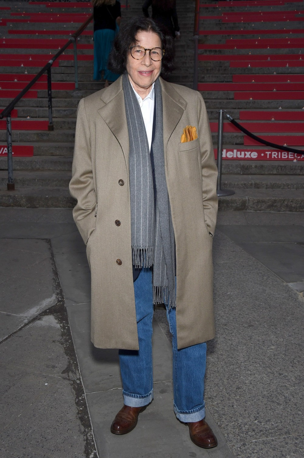 Image may contain Fran Lebowitz Clothing Apparel Shoe Footwear Coat Human Person Overcoat and Trench Coat