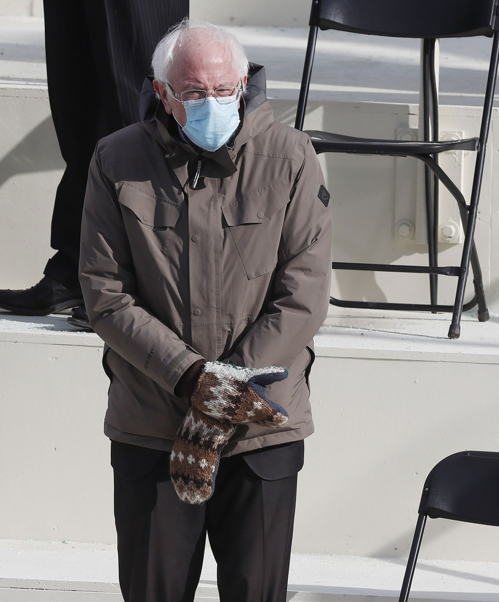 Senator Bernie Sanders of Vermont wearing a Burton coat and knit gloves by Jen Ellis at the inaugural ceremony. January...