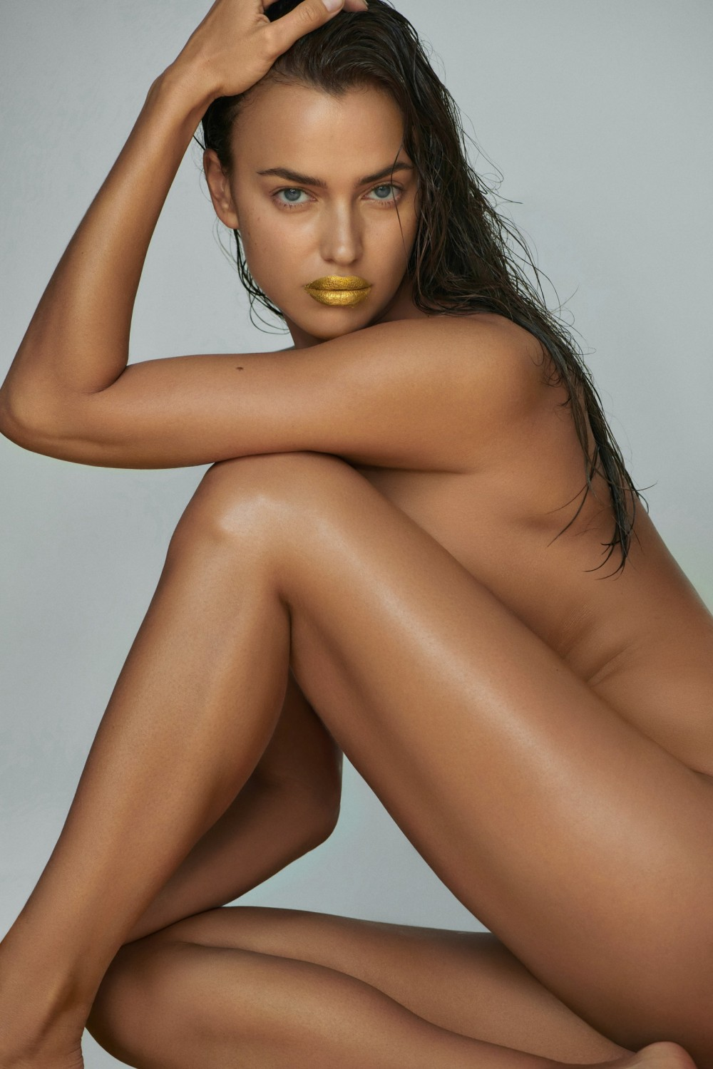 Irina Shayk of The Lions Talent nbspManagement wears a Mimi Luzon x Irina Shayk 24k Pure Gold Lip Treatment nbsp129...