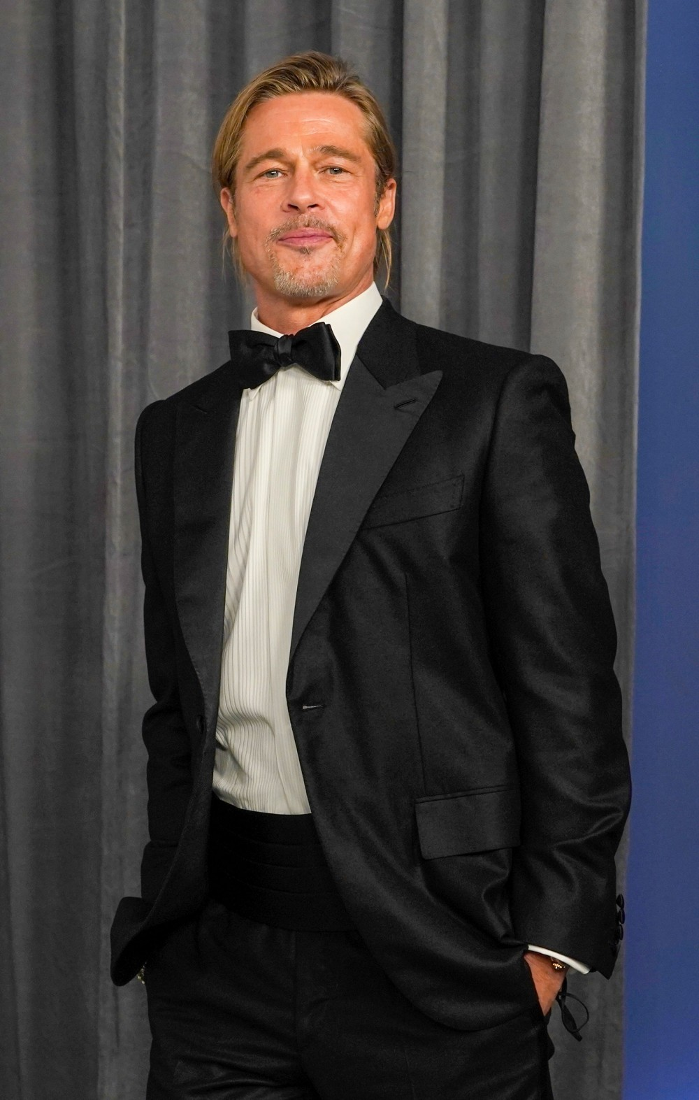 LOS ANGELES CALIFORNIA APRIL 25 Brad Pitt poses in the press room at the Oscars on Sunday April 25 2021 at Union...